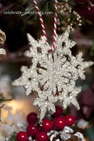 Glitter snowflakes - using blank wooden snowfkake ornaments, glitter glass,  & clear dry glue