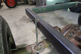 tack welding a piece of rebar from the rearend to the frame helps keep the ponents le as you work