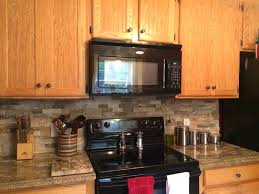 glass tile backsplash dark granite countertops white front maple kitchen cabinets subway tiles absolute black counter
