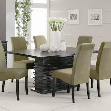 rectangle black wooden table bined with cream leather chairs with black wooden legs white floor dining