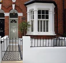Plastered rendered front garden wall painted white metal wrought ...