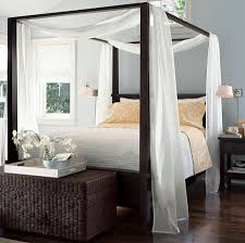 ... white four poster beds ...