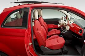 fiat 500 4 door interior. the fiat 500 interior is a well thought out place to be although smaller outside than mini inside it roomier 4 door