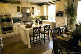 cream colored kitchen cabinets traditional antique white with black appliances