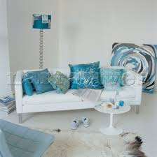 grey white and turquoise living room. contemporary coordinating living room with painted white floor boards sofa and turquoise w grey r