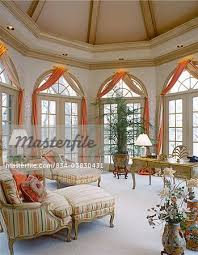 arched window treatments. WINDOW TREATMENTS: French Doors With Arched Windows Over Head. Scarf Drapes Treatment. Golden Pink Color Material In A Cream Room. - Stock Photo Window Treatments