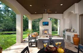 view in gallery tv above fireplace in the patio is a feature that saves up on space