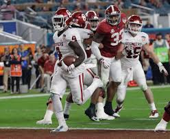 oklahoma running back trey sermon 4 scores a touchdown during the first half