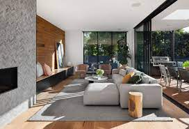 with grey walls and brown furniture