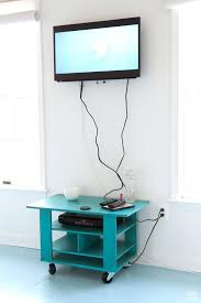 how to hide cords on a wall behind tv hiding cables brick mounted