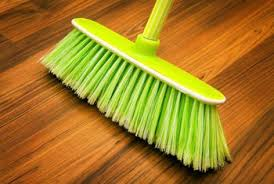 Use a soft-bristle broom to sweep your hardwood floors.