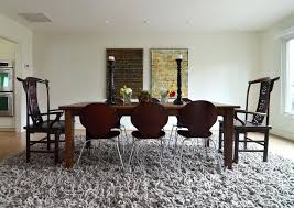 should you put a rug under a dining room table chic rug in dining room transitional with farm table next to simple front yard landscaping alongside rug