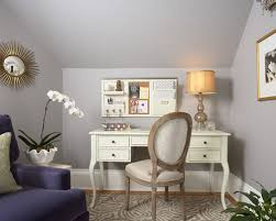 feminine home office. elegant freestanding desk medium tone wood floor home office photo in minneapolis with gray walls feminine m