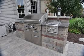 kitchen outdoor kitchen cost wall mounted range hood cherry cabinet mosaic glass backsplash tile subway