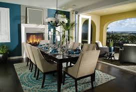 dark wood dining room furniture. dining area in open living space with blue and beige color scheme set off by dark wood room furniture i