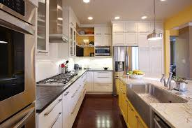 Inspiration for a transitional kitchen remodel in DC Metro with stainless  steel appliances, yellow cabinets