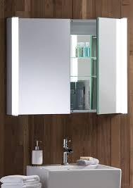 cool led illuminated bathroom cine mirror cabinet above rectangular white porcelain vessel sink and cherry wood