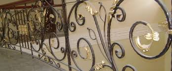 wrought iron railings with casted accessories in gold