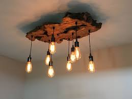 custom made medium live edge olive wood chandelier rustic and industrial light fixture