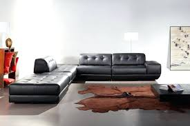 rug under sectional custom leather sectional sofa chaise with brown cowhide rug and modern flooring ideas