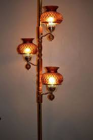 vintage 60s 70s tension pole lamp w amber glass shades 3 way switch