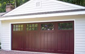 wood composite garage doors are just above steel in terms of they come primed and ready to paint with a limited lifetime warranty