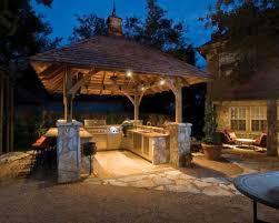 gallery outdoor kitchen lighting: stunning outdoor entertainment outdoor kitchen with beautiful lighting