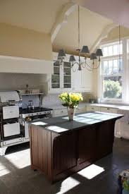 white kitchen wood island kelly and abramson kitchens traditional kitchen san francisco robert kelly jackie rowell kitchen cabinet corbels