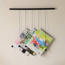 The Newspaper Table and Magazine Hanger - They are a product of designer  Isaac Yu Chen