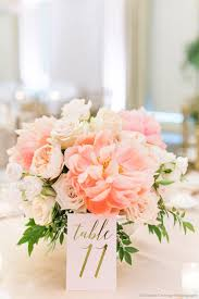 a lush spring time wedding table arrangement of faded coral charm peony,  peach juliet garden
