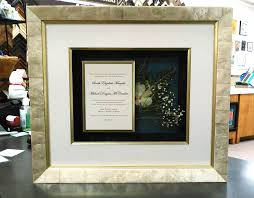 a stunning heartfelt piece a wedding invitation with dried fl arrangement in back a larson juhl moulding made with real seas and three layers of