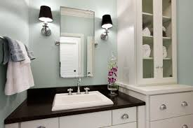 contemporary bathroom with green blue paint color rectangular pivot mirror flanked by restoration hardware lugarno sconces with black shades blue grey paint colors view