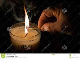 hand lighting. Black Background And A Hand Lighting Candle. Keep Candle Burning In The Memory Of Your Dreams. Fire, Smoke, Match, Lit Wick D