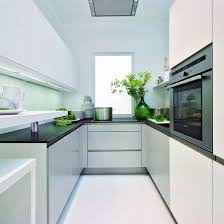 furniture for small kitchens. small kitchen with white cabinetry black worktops green glass vase and flooring furniture for kitchens