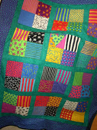 Wildcraft Farm: Lets Make Quilts ... Only One More Sleep!!! & What I like about this quilt is that it is very bright, very basic, but the  black quilting (one crazy heart stitched in each 4 patch) is the standout. Adamdwight.com