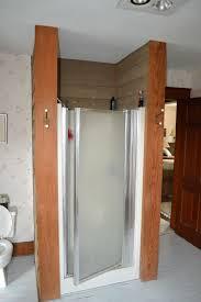 old fiberglass 36 x 36 shower with a flimsy framed shower door
