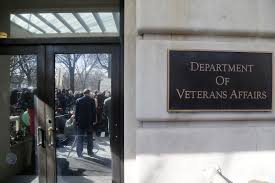 more than one third of calls to va suicide hotline are left department of veterans affairs secretary robert mcdonald reflected in doors facing reporters speaks