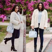 nihan wearing a white h m fur coat baby blue river island purse top jeans