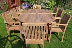 an outdoor wooden table and a set of outdoor chairs