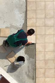 tile may be installed on a concrete slab as shown here or on a