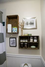 little house design bathroom with hex tile and hanging crates