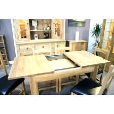 round oak extending dining table light and chairs
