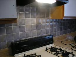 outstanding simple ceramic backsplash tile with big white stainless steel stove and u shape wooden cabinet