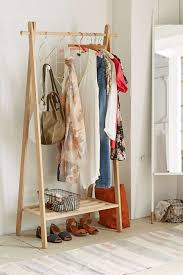 wooden clothing rack with a shelf for storage