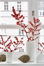 Die Skandinavische Weihnachtsdeko Mit Ilex Zweigen Ist Etwas