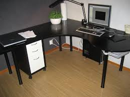 stylish black wooden corner desk with white drawers and arch study lamp