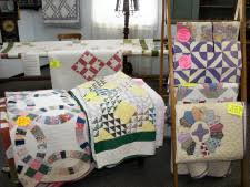 Amish Quilts - experience the real beauty of the real thing! & Helping Hands Quilt Shop and Museum Adamdwight.com