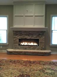 mounting flat screen tv above fireplace hiding wires electric linear with can you put firep