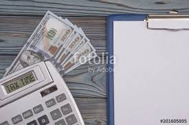 Time And Pay Calculator Concept Time To Pay Tax Calculator Money Dollars And A