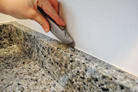granite countertop caulk backsplash cutting top portrayal wonderful removing the side splash from our bathroom sink